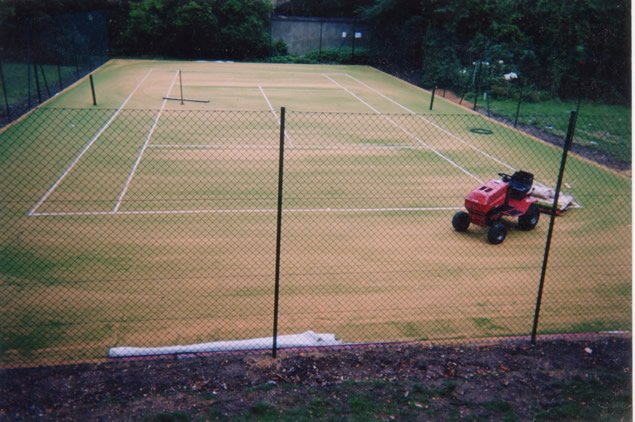 Tennis court being sanded with silica sand